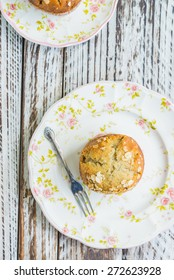 Banana muffin on wooden background