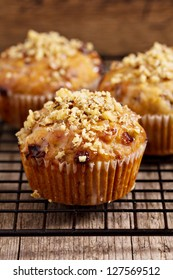 Banana muffins with walnuts and white chocolate on a cooling rack