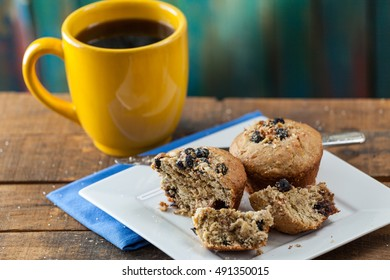 Banana Nut Muffin Served With Coffee For Breakfast On Vintage Rustic Wood Kitchen Table. Selective Focus With Copy Space.
