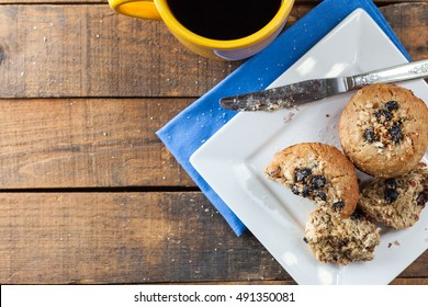 Banana Nut Muffin Served With Coffee For Breakfast On Vintage Rustic Wood Kitchen Table. Top View, Selective Focus With Copy Space.
