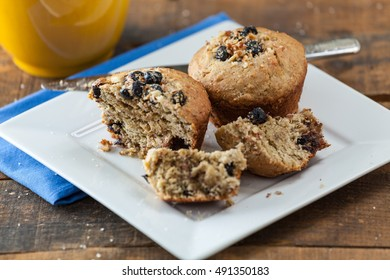 Banana Nut Muffin Sprinkled With Sugar Served With Coffee For Breakfast On Vintage Rustic Wood Kitchen Table. Selective Focus With Copy Space.