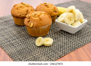 banana nut muffins with fresh bananas and walnuts