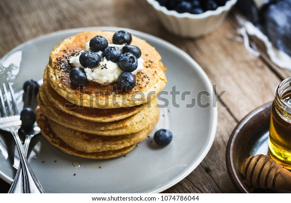 Banana Oat Pancakes with Blueberries, Coconut cream and Chia top