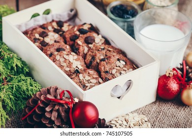 Banana oatmeal fitness cookies with raisins, cinnamon and chocolate. Healthy food, Christmas mood