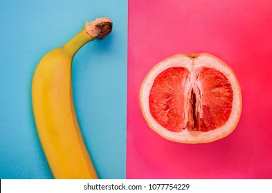banana on a blue background of a grapefruit on a pink background. The concept of difference is gender