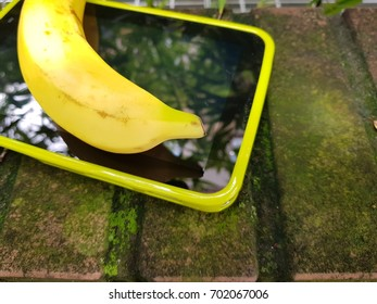 Banana on top of tablet pc. Apple