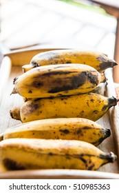 Banana on wooden tray, Thailand.