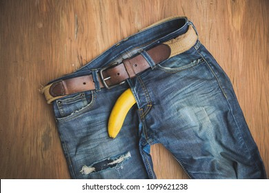 banana out of mens jeans like mens penis. potency concept