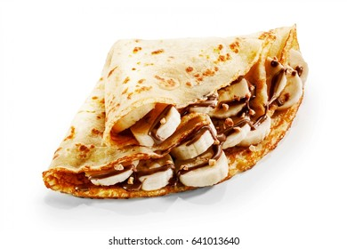Banana pancake crepes with chocolate sauce and chopped nuts for a tasty dessert folded over a white background for a menu or advertising
