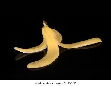 A banana peel against a black background.