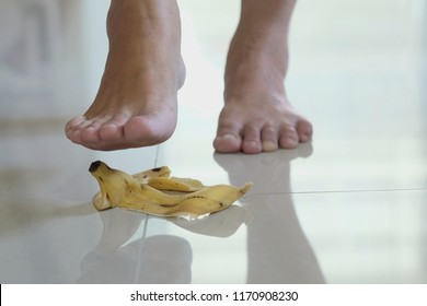 banana peel falls on the floor in home, people are stepping on.