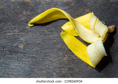 Banana peel on wood background close up