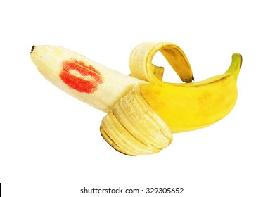 Banana with peeling and red imprint of lipstick on white background.  The allegory about sex, penis erection, role playing games, dildo, whore, escort, prostitution, BDSM