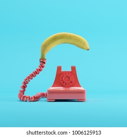 Banana phone with red vintage telephone on blue pastel color background. minimal idea concept.