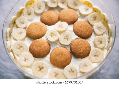 Banana pudding, popular in the Southern United States, made with vanilla wafer cookies, pudding, whipped cream and sliced bananas. Shown in a trifle bowl.