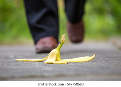 A banana skin lies on a walkway