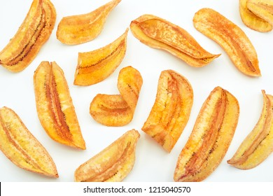 banana slice chips top view on white background.