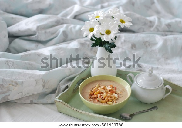 Banana smoothie bowl breakfast in bed