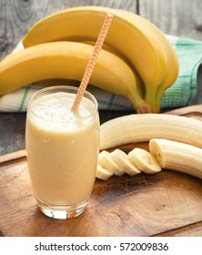 Banana smoothie on a rustic wooden table