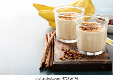 Banana smoothie with peanut butter, cinnamon and granola for healthy breakfast