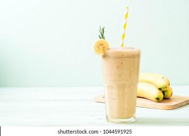 banana smoothies glass on wood table