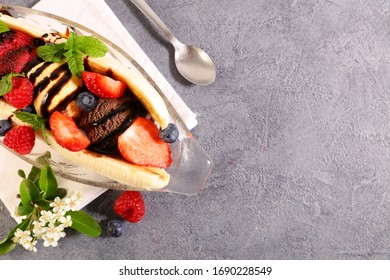 banana split- banana with icre cream and berries fruits