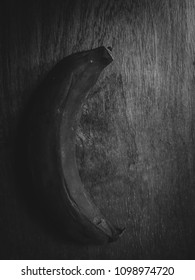 banana spoiled on wood floor in black and white and high contrast