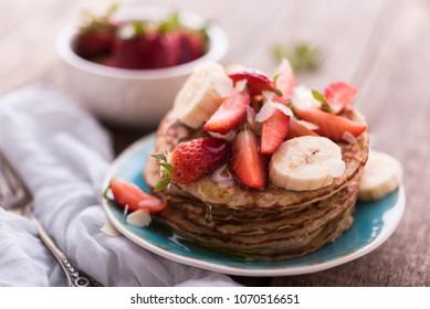 Banana and strawberries pancakes