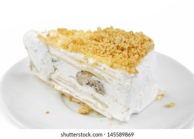 banana stuff cake with peanut meal on white