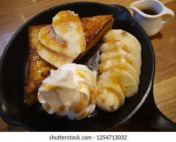 Banana Toast with caramel sirius and ice cream topping whipped cream is a luscious and delicious dessert.