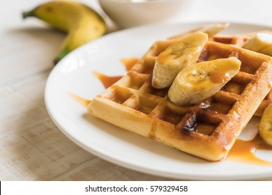 banana waffle with caramel on white plate
