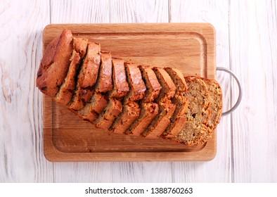 Banana wholemeal cake, sliced on wooden board