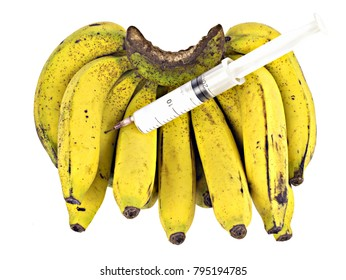 Banana,injection needle and chemical pesticides isolated on white  background with clipping path.Concept pesticide residues in fruits and vegetables.