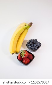 Bananas, blueberries and strawberries.