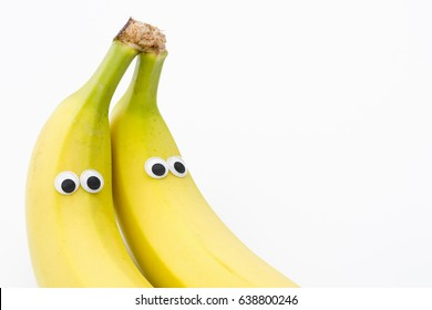 bananas with googly eyes on white background - banana face