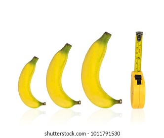 Bananas and measuring tape isolated on white background with clipping path.Concept men penis size big and small.Object sign symbols for sex education and healthcare medical.