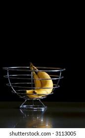 Bananas in metal basket