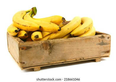 Bananas in an old box on a white background.