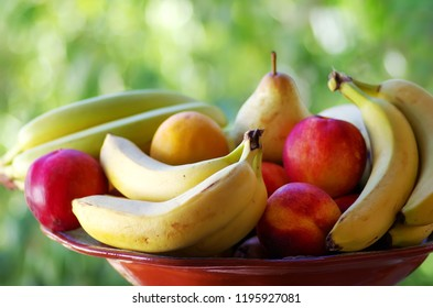 bananas, pear and peaches on basket