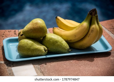 bananas and pears on blue tray