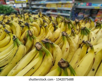 bananas for sale in supermarket in the section of hortifruti, with background unfocused