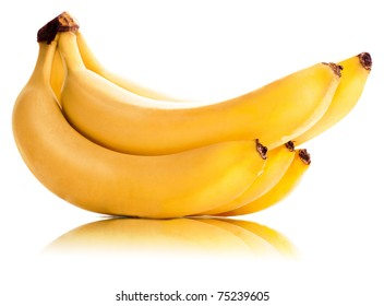 Bananas in a sheaf sweet ripe yellow isolated on a white background with a darkness and reflection