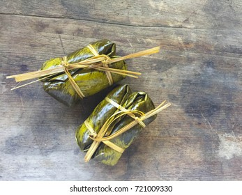 Bananas with Sticky Rice   on wooden background