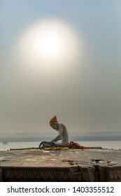 Banaras, Uttar Pradesh, India - February 19th, A Sadhu, devotee of Lord Shiva performing his daily morning rituals.