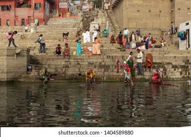 Banaras, Uttar Pradesh, India - February 19th, 2017. Early morning activities by the Ghats of Banaras on Ganges river.