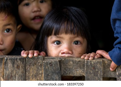 BANAUE, PHILIPPINES, DECEMBER 04 : An unidentified Filipino little girl with her brothers and sisters is staring at the camera in the village of Banaue, north Luzon, Philippines, on December 04, 2013