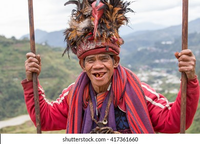 BANAUE, PHILIPPINES - JANUARY 24, 2014 : Portrait old Filipino man of Ifugao mountain tribes in national dress next to rice terraces. Ifugao - the  mountain people in the Philippines.
