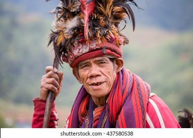 BANAUE, PHILIPPINES - JANUARY 24, 2014 : Portrait old Filipino man of Ifugao mountain tribes in national dress next to rice terraces. Ifugao - the mountain people in the Philippines