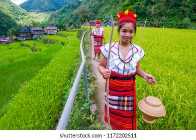 BANAUE, PHILIPPINES - MAY 02 : Women from Ifugao Minority near a rice terraces in Banaue the Philippines on May 02 2018. The Ifugao minority mostly live in the mountains of north Philippines
