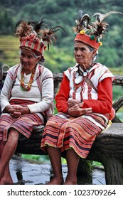 Banaue, Philippines-October 8, 2016: Some elderly Ifugaos -men and women- still dress in their traditional attire and headdress while sitting by the rice terraces cultural landscape. Cordillera region